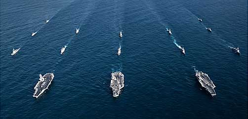 The aircraft carriers USS Ronald Reagan, USS Theodore Roosevelt, USS Nimitz and their strike groups along with ships from the South Korean Navy as they transit the Western Pacific, Nov. 12, 2017. The strike groups are underway and conducting operations in international waters as part of a three-carrier strike force exercise. Navy photo by Lt. Aaron B. Hicks. - ALLOW IMAGES