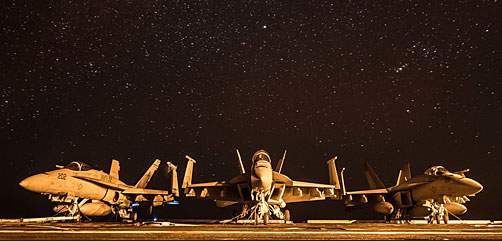 Three F/A-18 Hornets rest on the flight deck of the aircraft carrier USS Theodore Roosevelt (CVN 71) in the Arabian Gulf on Dec. 22, 2017. Theodore Roosevelt and its carrier strike group are deployed to the U.S. 5th Fleet area of operations in support of maritime security operations to reassure allies and partners and preserve the freedom of navigation and the free flow of commerce in the region. (U.S. Navy photo by Mass Communication Specialist 3rd Class Spencer Roberts) - ALLOW IMAGES