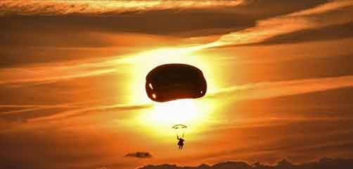 An Army paratrooper descends to the ground at Rivolto Air Base in Udine, Italy, Sept. 26, 2017, during Exercise September Heat 2017. The soldier is assigned to the 173rd Airborne Brigade. Army photo by Paolo Bovo. - ALLOW IMAGES