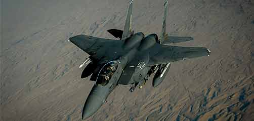 A U.S. Air Force F-15E Strike Eagle departs after receiving fuel from a 908th Expeditionary Air Refueling Squadron KC-10 Extender during a flight in support of Operation Inherent Resolve June 2, 2017. The F-15E Strike Eagle is a dual-role fighter designed to perform air-to-air and air-to-ground missions. An array of avionics and electronics systems gives the F-15E the capability to fight at low altitude, day or night, and in all weather. (U.S. Air Force photo by Staff Sgt. Michael Battles) - ALLOW IMAGES