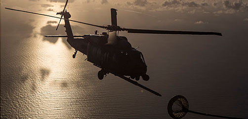An HH-60G Pave Hawk refuels from an HC-130P/N King. (U.S. Air Force photo by Master Sgt. Mark Borosch). - ALLOW IMAGES