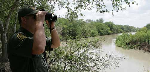 Border Patrol Officer Scanning River - ALLOW IMAGES