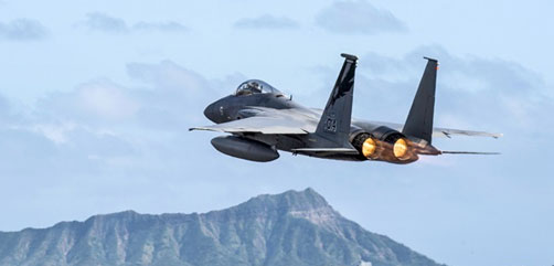 A California Air National Guard F-15 Eagle takes flight near Diamond Head during the Sentry Aloha 18-01 training exercise at Joint Base Pearl Harbor-Hickam, Hawaii, Jan. 22, 2018. Air National Guard photo by Senior Master Sgt. Chris Drudge. - ALLOW IMAGES