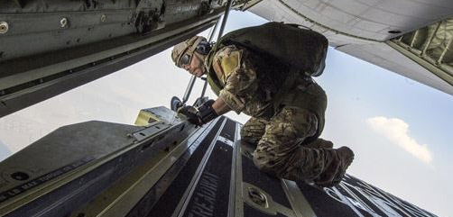 An airman checks the conditions for a high altitude, low opening jump during exercise Mobility Guardian while flying over Washington state, Aug. 7, 2017. The exercise aims to sharpen airmen's skills to support combatant commander requirements. Air Force photo by Senior Airman Clayton Cupit.  - ALLOW IMAGES