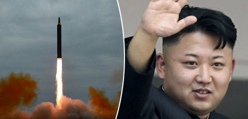 Kim Jung Un along with North Korea's new Hwasong-15 intercontinental ballistic missile - ALLOW IMAGES