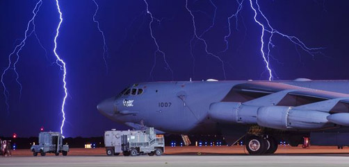 Lightning strikes behind a B-52H Stratofortress at Minot Air Force Base, N.D., Aug. 8, 2017. The B-52 can conduct strategic attacks, close-air support, air interdiction, offensive counter-air and maritime operations. Air Force photo by Senior Airman J.T. Armstrong. - ALLOW IMAGES