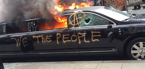 Limo burned during inauguration protests - ALLOW IMAGES