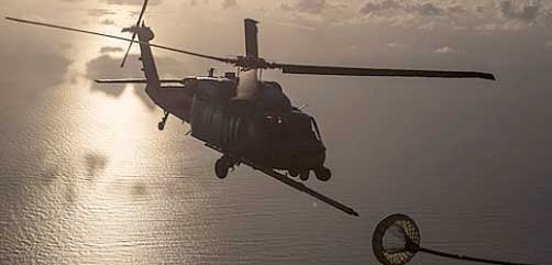 An HH-60G Pave Hawk refuels from an HC-130P/N King enroute to rescue two German citizens in distress at sea July 7, 2017 and into July 8. The victim's vessel caught fire approximately 500 nautical miles off the east coast of southern Florida. At the request of the U.S. Coast Guard's Seventh District in Miami, the 920th RQW was alerted by the Air Force Rescue Coordination Center at Tyndall Air Force Base, Florida, to assist in the long-range search and rescue. Approximately 80 wing Citizen Airmen and four wing aircraft helped execute the rescue mission to include, maintenance, operations and support personnel. (U.S. Air Force photo by Master Sgt. Mark Borosch)  - ALLOW IMAGES