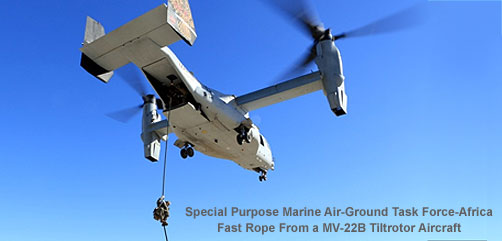A Marine with Special Purpose Marine Air-Ground Task Force-Africa conducting helicopter rope suspension training from an MV-22B Osprey - ALLOW IMAGES