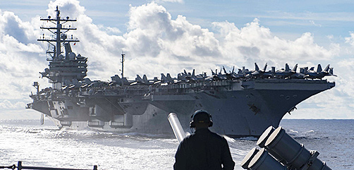 The guided-missile cruiser USS Chancellorsville during a replenishment-at-sea with the aircraft carrier USS Ronald Reagan. Mass Communication Specialist 2nd Class John Harris/U.S. Navy/Flickr - ALLOW IMAGES