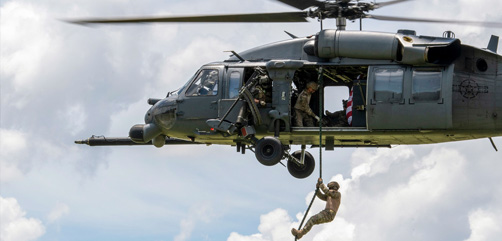 Air Force Maj. Kyle Yates, 824th Base Defense Squadron commander, fast-ropes out of an HH-60G Pave Hawk during training at Moody Air Force Base, Ga., July 24, 2020. - ALLOW IMAGES