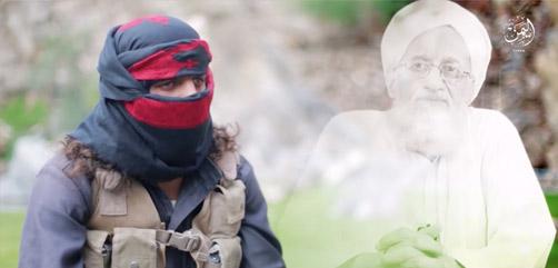 A masked Islamic State fighter in Yemen criticizes Al Qaeda's Ayman al-Zawahiri. - ALLOW IMAGES