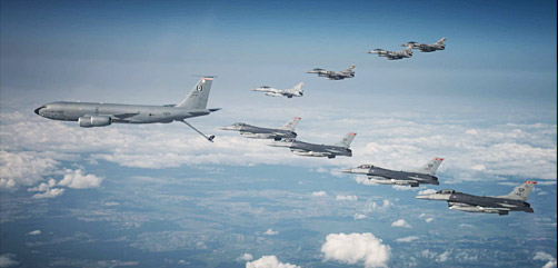 An Air Force KC-135 Stratotanker leads a joint formation of F-16 Fighting Falcons during Astral Knight in Poland, Sept. 17, 2020. The joint, multinational exercise involves U.S. airmen and soldiers working with service members from Poland, Latvia, Lithuania, Estonia and Sweden.- ALLOW IMAGES