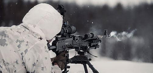 A Marine participates in a live-fire range during arctic cold-weather and mountain warfare training in Setermoen, Norway, Feb. 23, 2021.  - ALLOW IMAGES