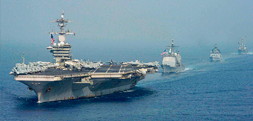 The USS Theodore Roosevelt, the USS Bunker Hill, the Indian navy Shivalik-class INS Shivalik and the USS Russell sail in formation in the Indian Ocean, March 28, 2021. - ALLOW IMAGES