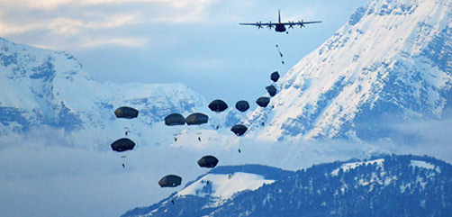 Soldiers conduct an airborne operation from an Air Force C-130 Hercules aircraft at Frida drop zone in Pordenone, Italy, Feb. 1, 2021. - ALLOW IMAGES