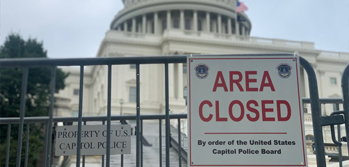 Fencing and baracades have returned to the US Capitol in preparation for a September rally. Image: Ahtra Elnashar - ALLOW IMAGES