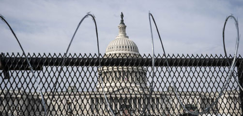 Troops, riot fencing and razor wire currently surround the U.S. Capitol Complex.- ALLOW IMAGES