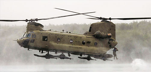 A soldier jumps from an Army CH-47 Chinook into a lake during helocast training at Joint Base Elmendorf-Richardson, Alaska, Aug. 17, 2021. - ALLOW IMAGES