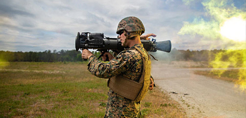 Marine Corps Cpl. Andrew Ritchie uses a weapon system during live-fire training at Camp Lejeune, N.C., May 6, 2021. - ALLOW IMAGES