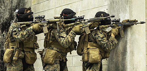 U.S. Marines conduct urban operations within the Central Training Area on Okinawa, Japan, April 8, 2021. - ALLOW IMAGES