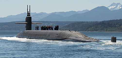 July 12, 2018: The Ohio-class ballistic missile submarine USS Nebraska (SSBN 739) transits the Hood Canal as it returns home Naval Base Kitsap-Bangor, Washington, following the boat's first strategic patrol since 2013. Nebraska recently completed a 41-month engineered refueling overhaul, which will extend the life of the submarine for another 20 years. (U.S. Navy photo by Mass Communication Specialist 1st Class Amanda R. Gray). - ALLOW IMAGES